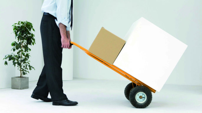©Ale Ventura/6PA/MAXPPP ; Businessman moving boxes with hand truck